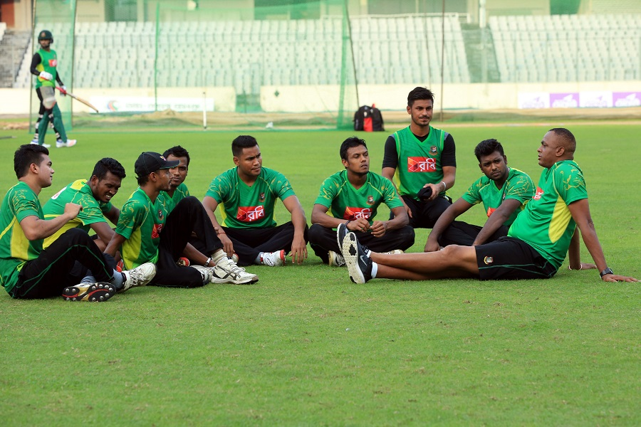 a-group-of-pace-bowlers-keenly-listen-as-courtney-walsh-addresses-them-during-a-training-session-mirpur-september-20-2016