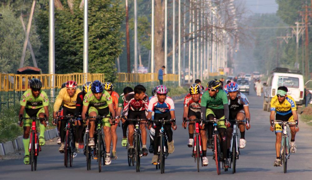 Cyclists practicing on Srinagar -Gulmarg highway in kashmir.