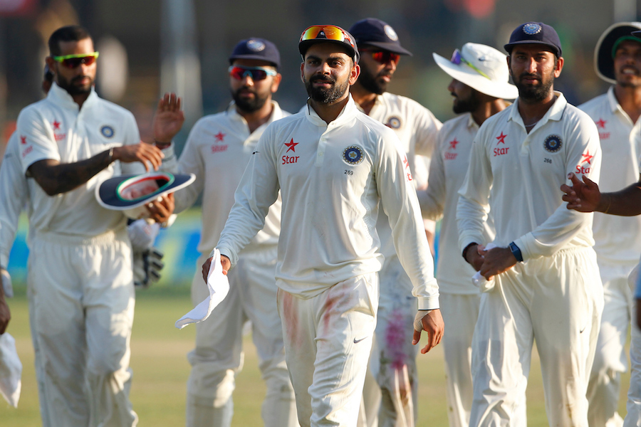 Virat Kohli Captain of India and team player walk bach after the finsh day 4 of the first test match between India and New Zealand held at the Green Park stadium on the 25th September 2016. Photo by: Deepak Malik/ BCCI/ SPORTZPICS