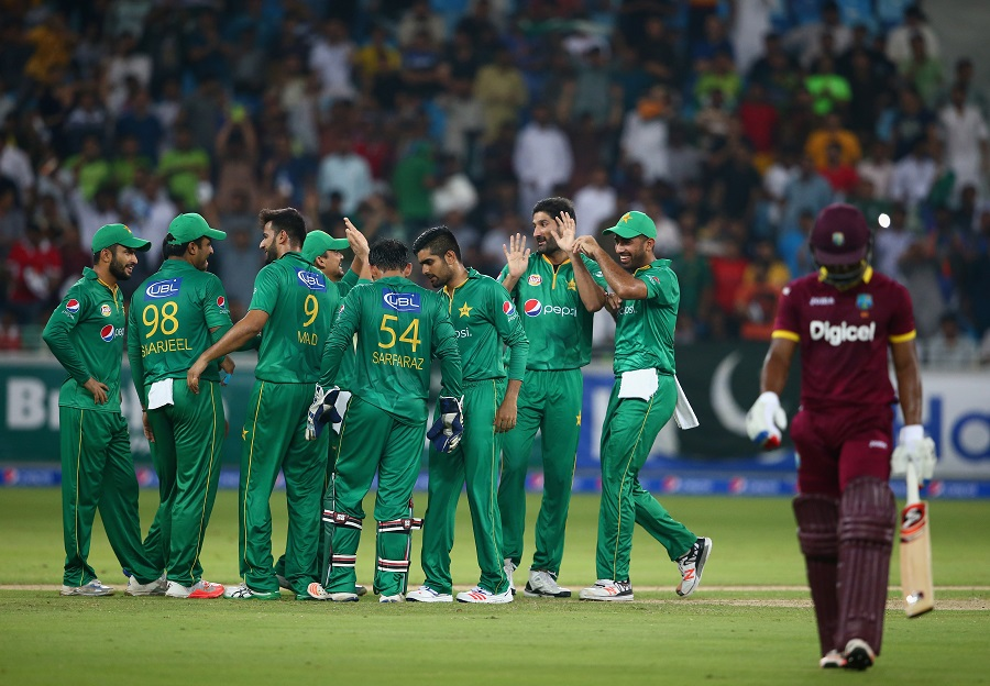 DUBAI, UNITED ARAB EMIRATES - SEPTEMBER 24:  Sohail Tanvir of Pakistan celebrates wirh teammates after dismissing Evin Lewis of West Indies during the second T20 International match between Pakistan and West Indies at Dubai International Cricket Stadium on September 24, 2016 in Dubai, United Arab Emirates.  (Photo by Francois Nel/Getty Images)