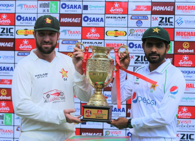 Pakistan captain Babar Azam and Zimbabwe captain with trophy ahead of test series. Pic/PCB