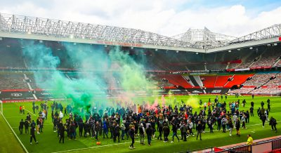 Angry fans storm into Manchester United Old Trafford pitch