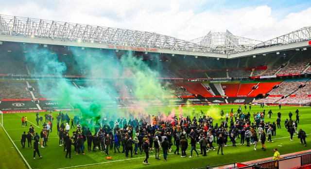 Angry fans storm into Manchester United Old Trafford pitch. Pic/Twitter